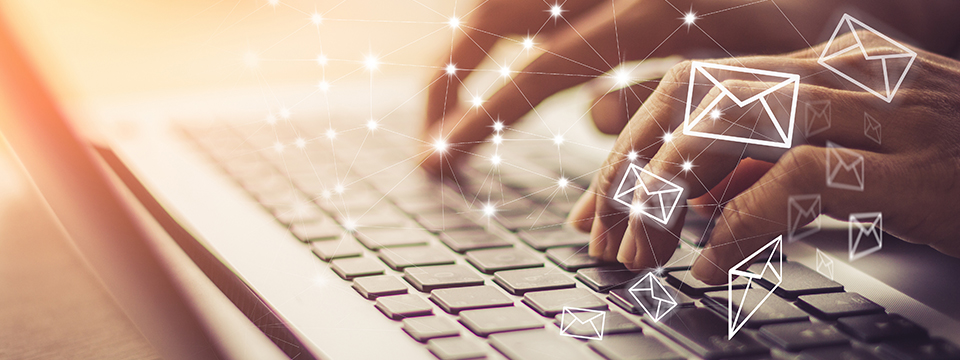 Business woman hand using laptop PC with email icon. Email concept.