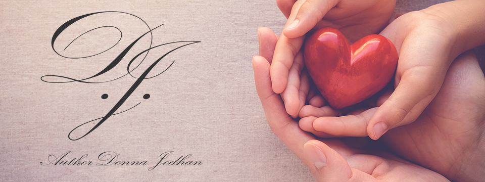 Inside of a parents hands lie their child's hands. Inside of the child's hands sits a shiny red wooden heart. Concepts of hope, faith and charity. To the left is the Author Donna Jodhan logo.