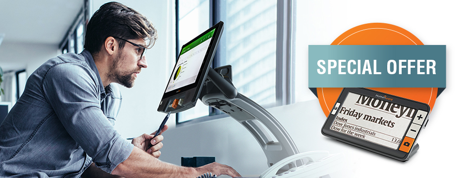 Middle-aged professional at work looking at graph using a Reveal 16i, HumanWare's all-in-one digital magnifier, and an image of an Explor� 5 handheld portable digital magnifier with the SPECIAL OFFER mention.
