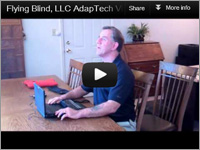 YouTube Video Thumbnail showing Larry Lewis of Flying Blind, LLC sitting at a large table with a Brailliant in front of him.
